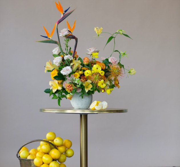 flower arrangement on a gold table