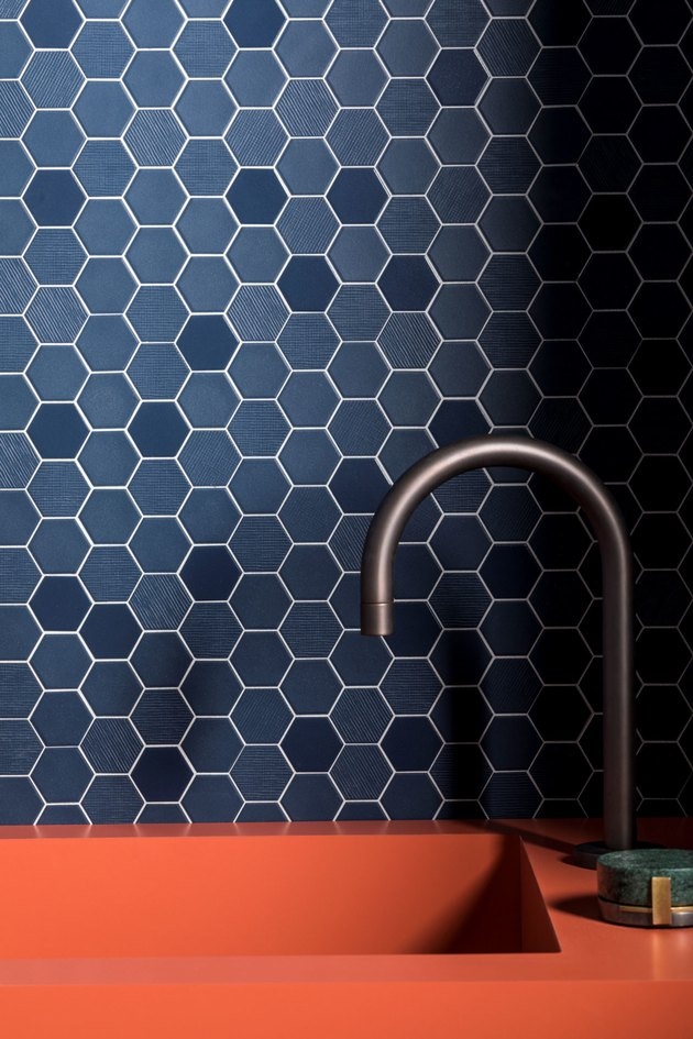 blue hex mosaic kitchen backsplash with coral sink