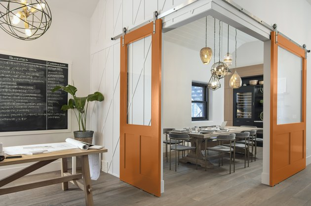 dining space with orange doors
