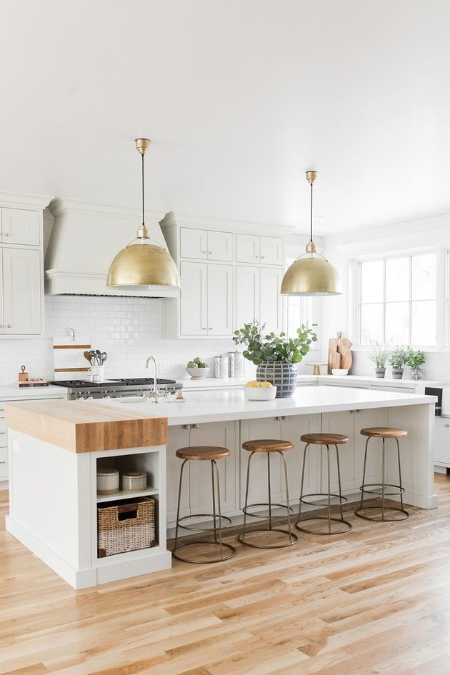 small kitchen island idea with butcherblock and white countertop with brass pendants