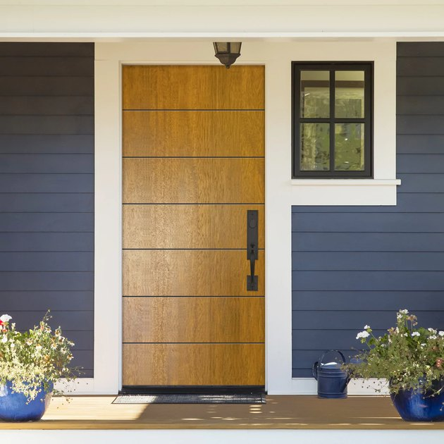 modern exterior door in wood with traditional details