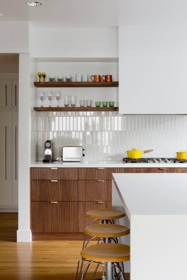 high gloss subway tile kitchen splashback with walnut details