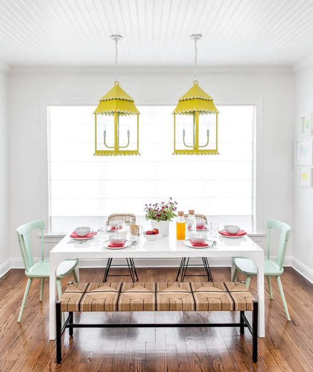chartreuse color idea in white dining room with chartreuse pendants over table