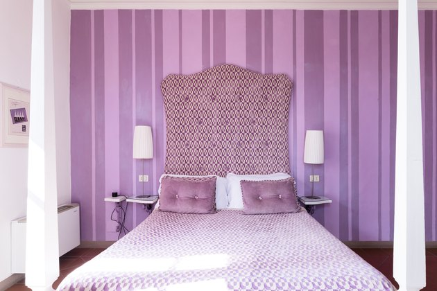 purple striped bedroom with large bed and cool colors