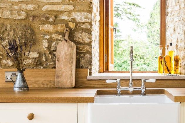 short wood kitchen backsplash with stone accent walls in farmhouse kitchen