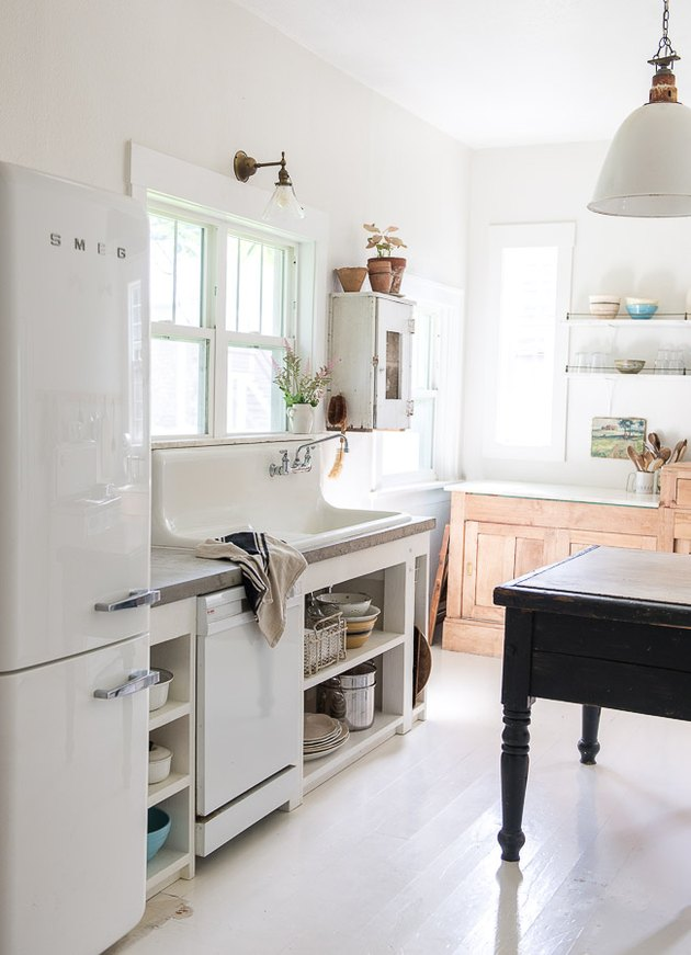 Industrial farmhouse kitchen with vintage decor and concrete countertop