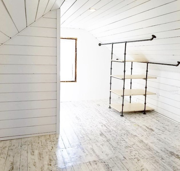 Custom industrial closet ideas in white shiplap attic