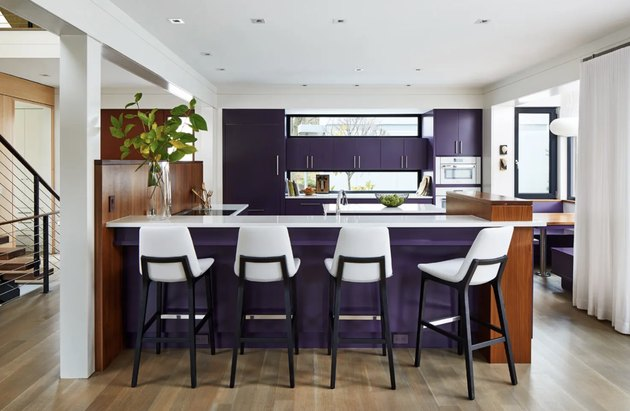 kitchen with white chairs and eggplant cool colors on the cabinets