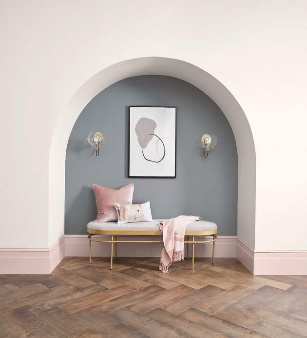 alcove with pink baseboards and blue-gray wall