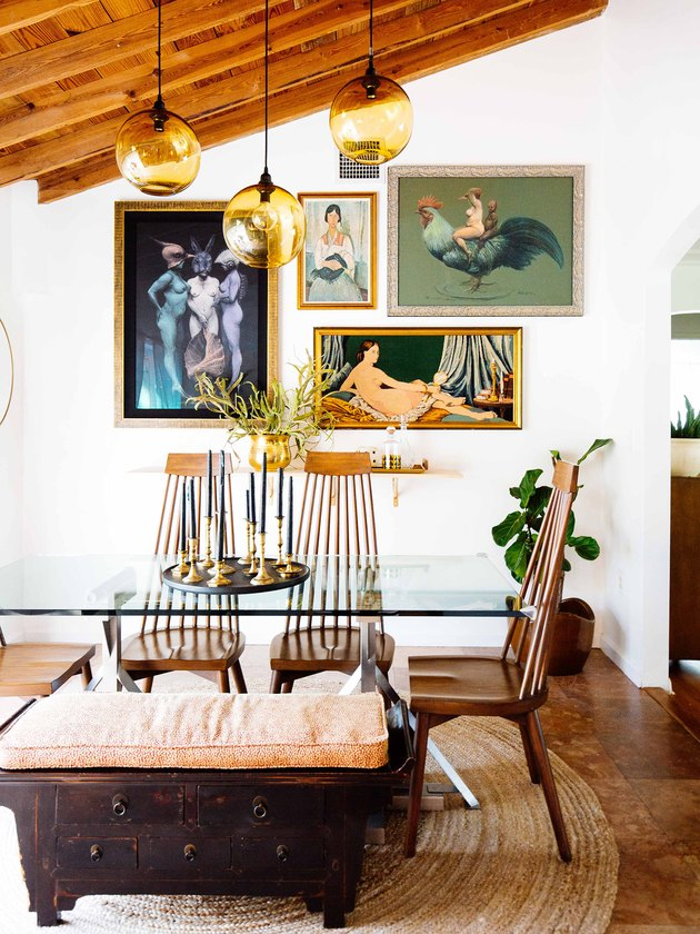 vintage midcentury modern furniture in dining room with glass table and wood chairs
