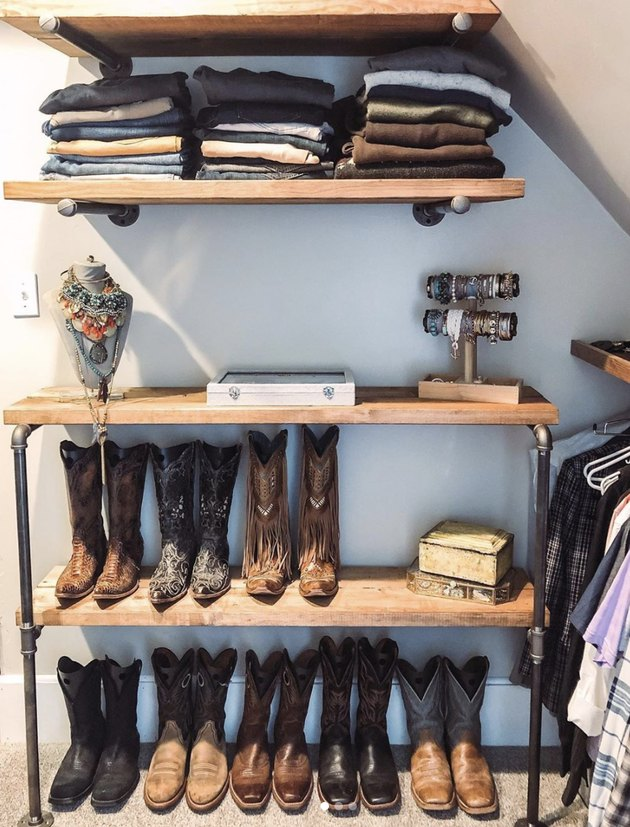 Custom industrial closet ideas with wood shelves and cowboy boots