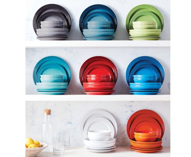 colorful dinnerware on white shelvers