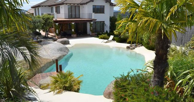 sand pool in front of a house