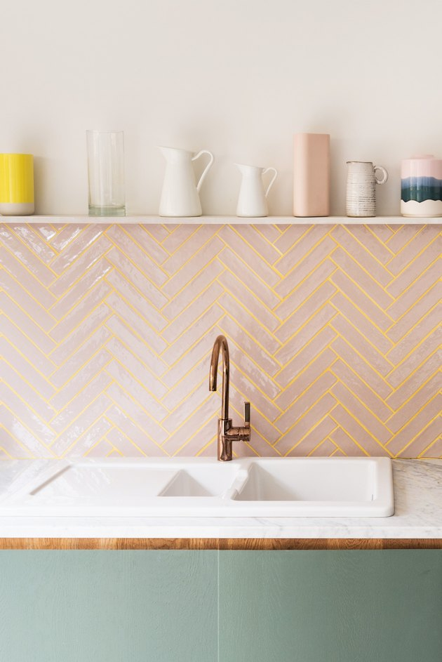 pink subway tile kitchen backsplash with yellow colored grout