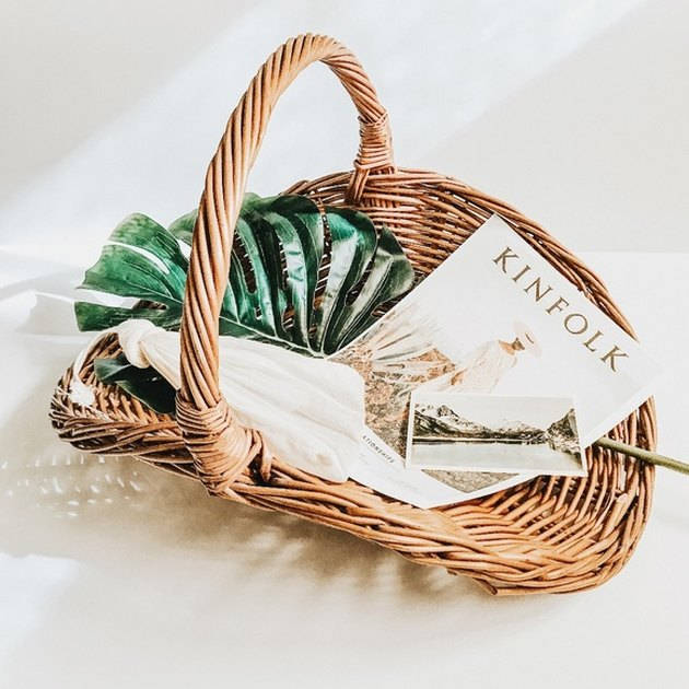 wicker basket with plant and magazines