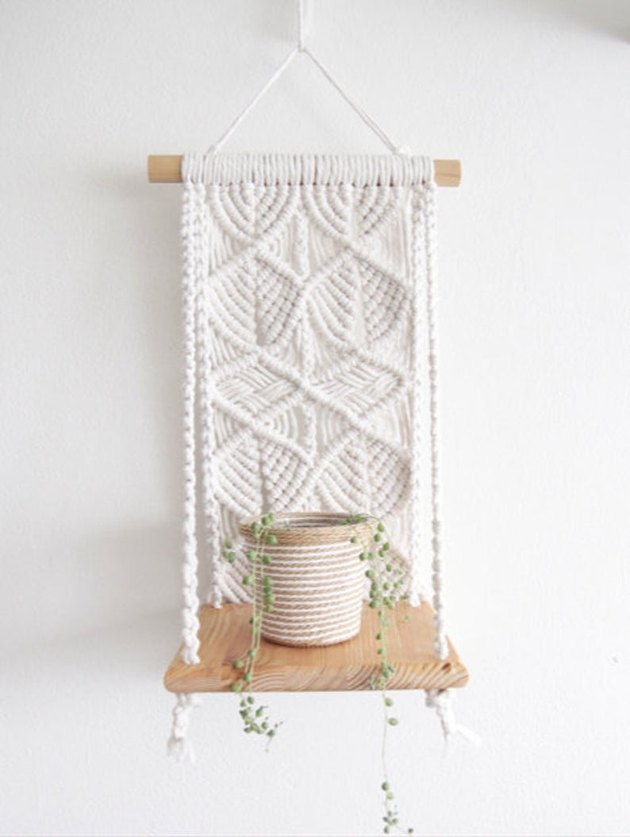 Macrame hanging shelf with wooden shelf
