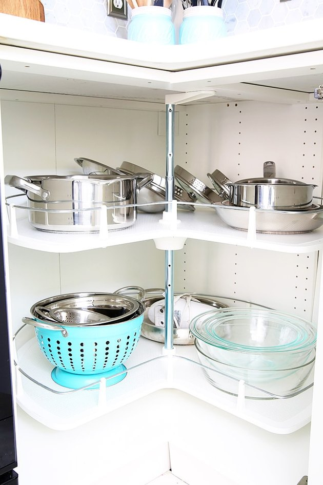 small kitchen organization idea with lazy Susan in cabinet