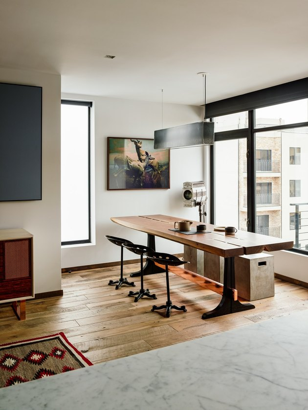 white industrial color palette in dining room with walnut table and steel paned windows