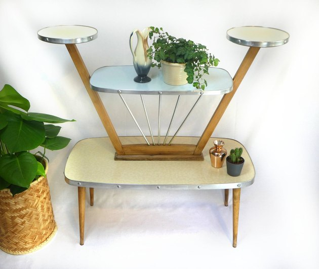 Formica and wood vintage plant stand with four shelves of various heights and sizes