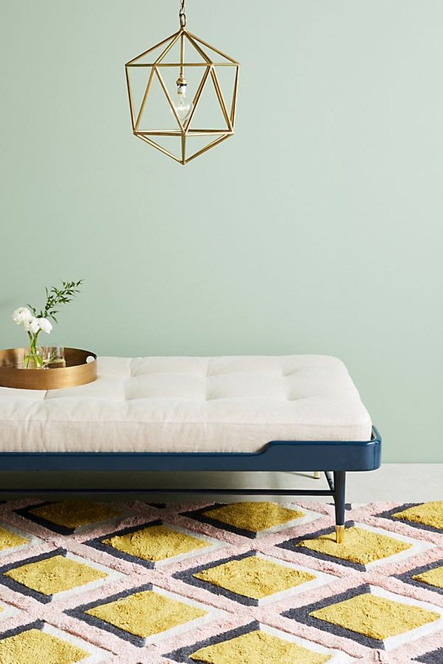 anthropologie daybed with geometric pendant