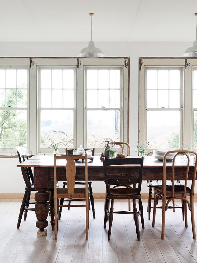 rustic dining room with mismatched chairs