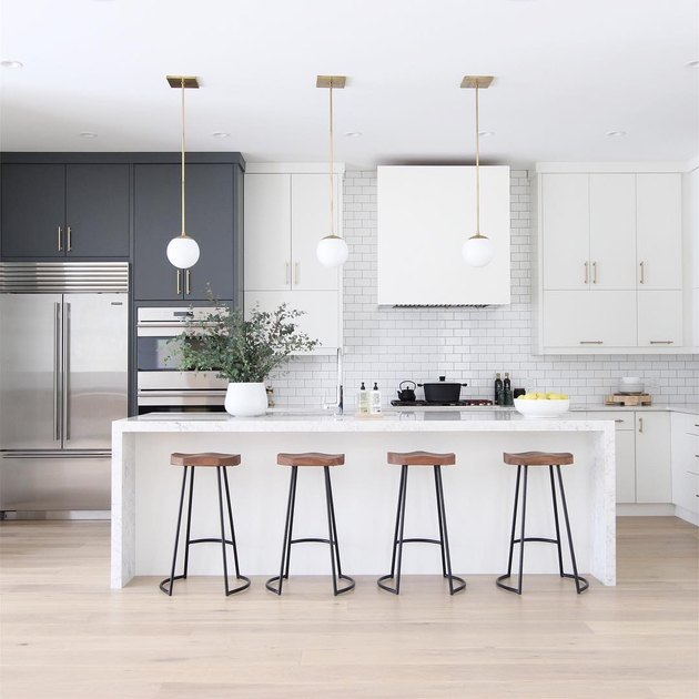 kitchen island lighting idea with globe-style pendants