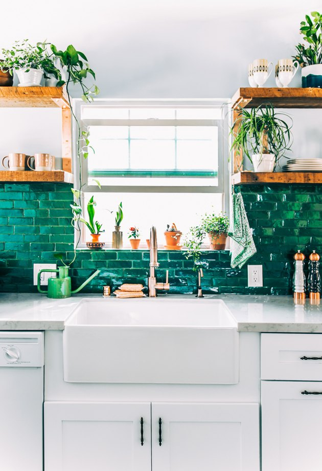 mosaic green kitchen backsplash tile with white cabinets and farmhouse sink