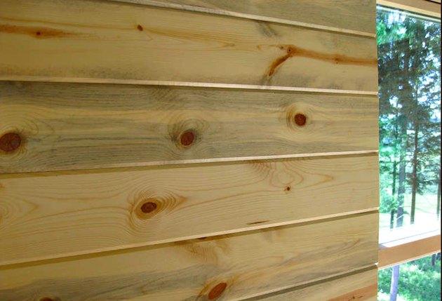 Pine wall paneling.