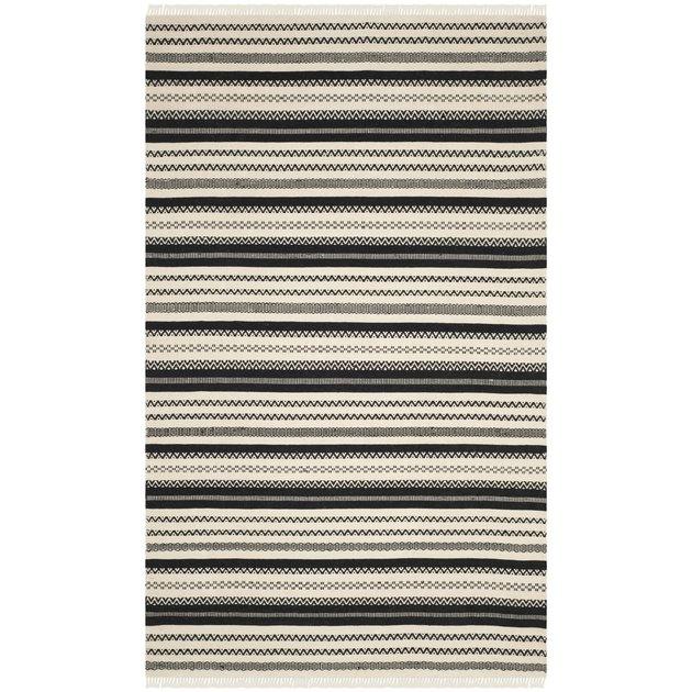 Black and cream-striped kilim rug