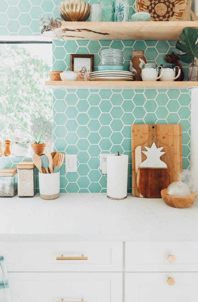 mint green kitchen backsplash with white cabinetry and white countertops