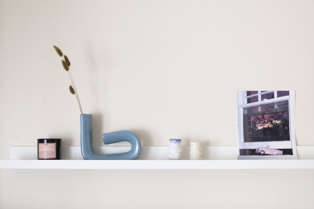 shelf with sculptures and a photograph