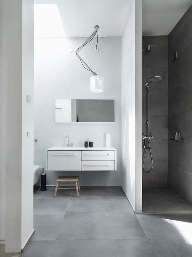 A dark concrete shower