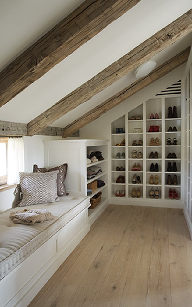 Attic Closet Ideas with shoe storage and exposed beams and window seat