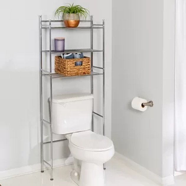 toilet with shelves over it