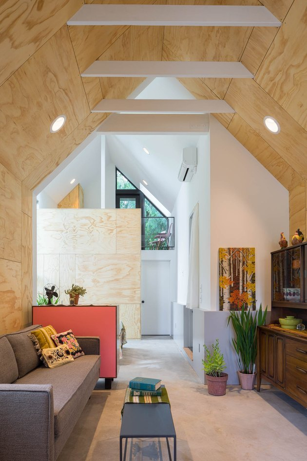 living room space with wood walls