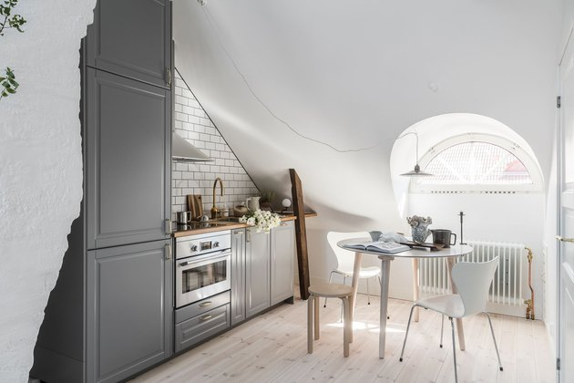 white attic kitchen with small table and chairs