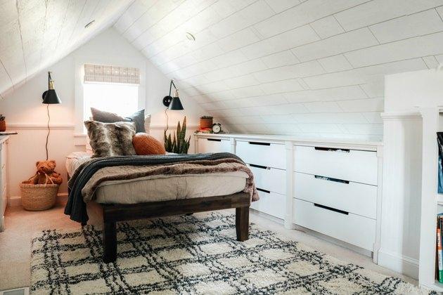 farmhouse attic bedroom lighting ideas with black wall sconces