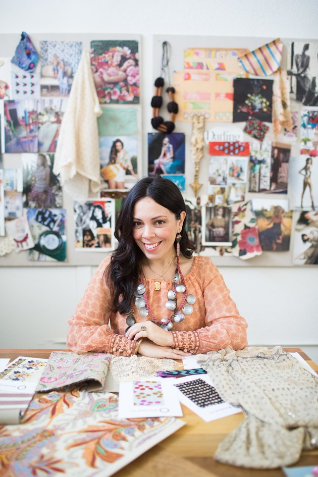 Williams at work, in front of inspiration boards that are as colorful and original as she is.