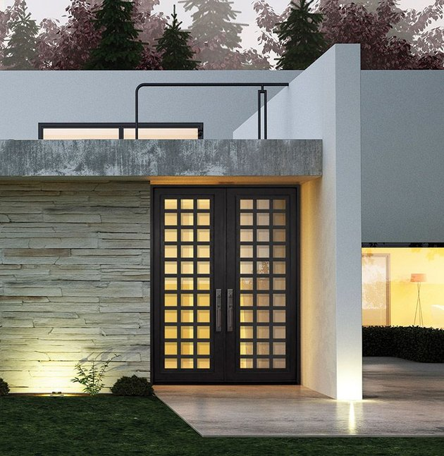 modern exterior door with black and window inserts