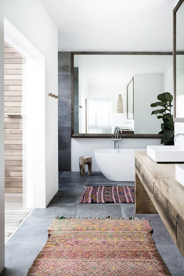 bathroom with area rugs on concrete floor