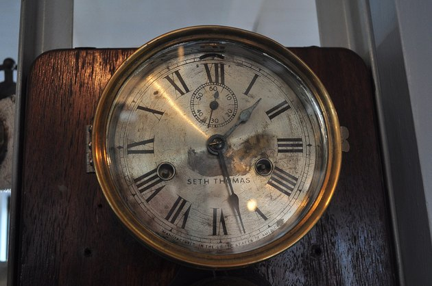 a tarnished Seth Thomas wall clock in the Virginia V historic ship's engine room
