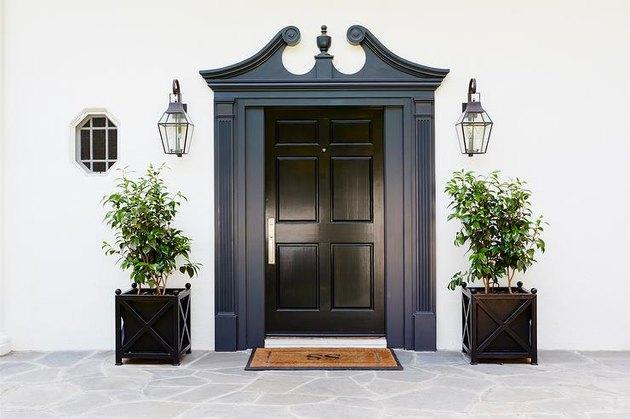 exterior door trim on black front door with extravagant navy trim