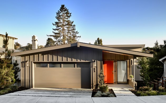 Bay Area midcentury modern home with board and batten exterior and red door