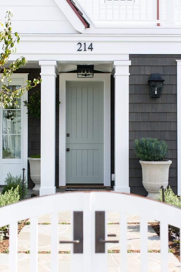 exterior door trim on gray and white home exterior with thick white door trim