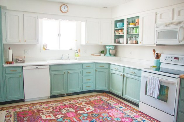 modern white and aqua color kitchen with colorful printed rug