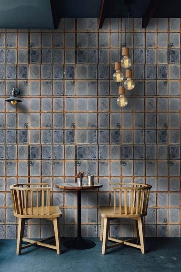 blue and gray industrial wallpaper with table and chairs in front