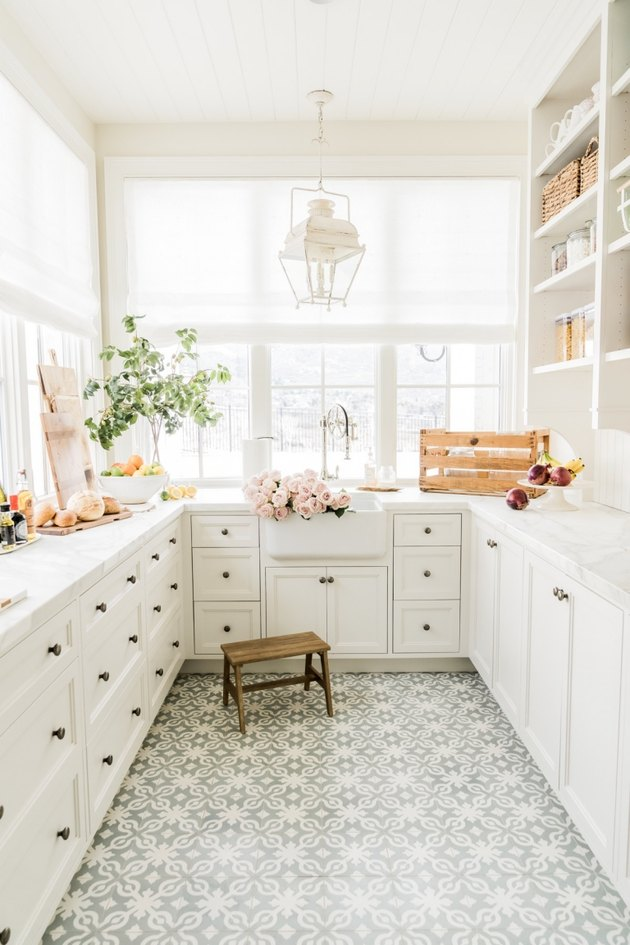 ivory color idea in pantry with ivory cabinets and patterned floor tile