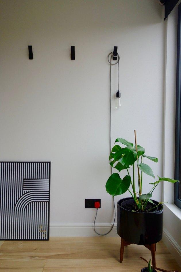 loft attic bedroom lighting ideas with cord light on wall hook