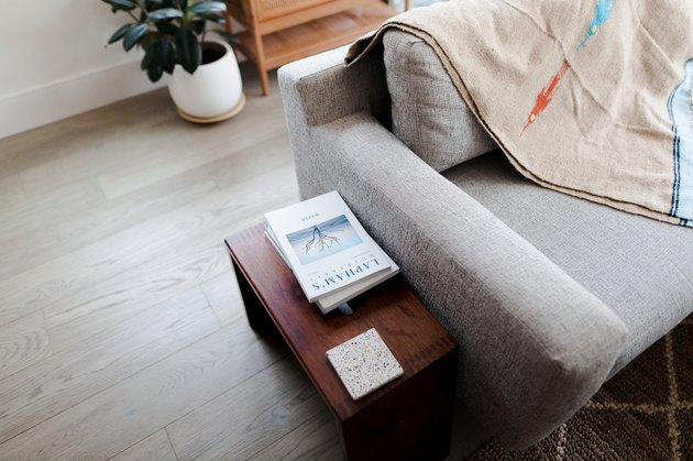 Books on side table next to modern sofa