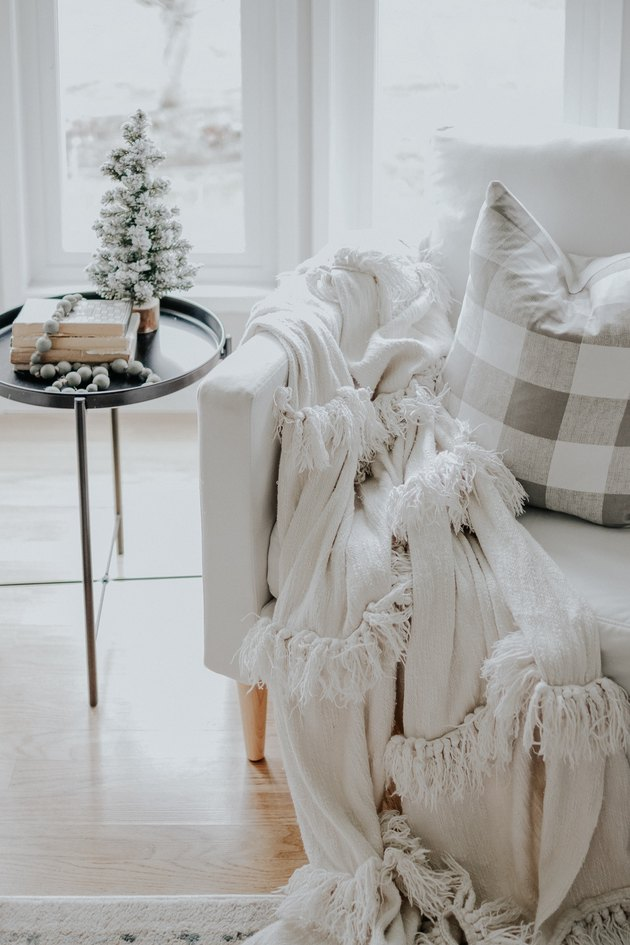 Rustic Christmas decorations in natural colors with living room chair and side table